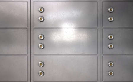 safety box: A closeup of a wall of closed metal safety deposit boxes