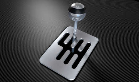 carbon fibre: A steel chrome and carbon fibre gear stick shift with an exposed plate on a carbon fibre surface