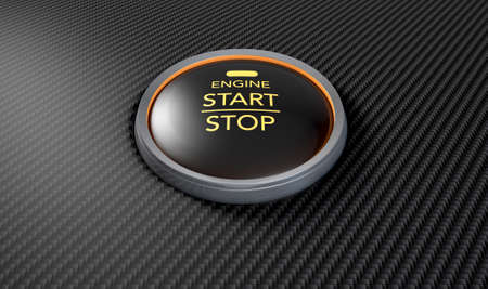 button: A closeup of a modern car start and stop button with blue lights on a carbon fibre textured surface