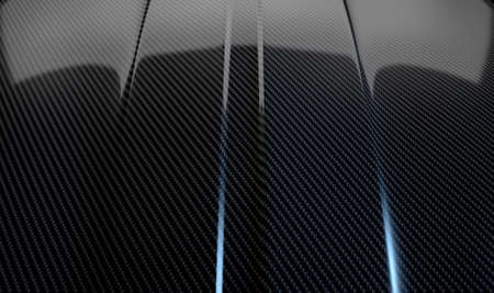 carbon fibre: An abstract section of the contours of a carbon fibre automobile bonnet with dramatic lighting on a dark studio background Stock Photo