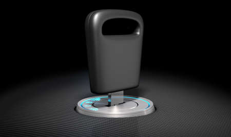 inserted: A modern chrome and blue light car ignition with a simple key inserted on a carbon fibre surface
