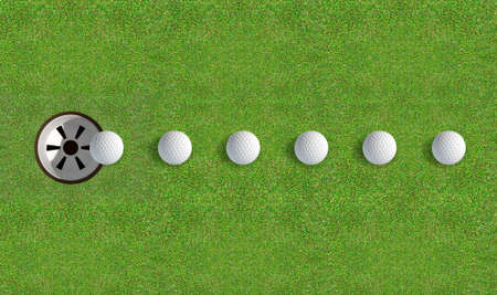 holed: A perfectly manicured golf putting green showing a ball in motion on its way to the hole in the daytime on a blue sky background