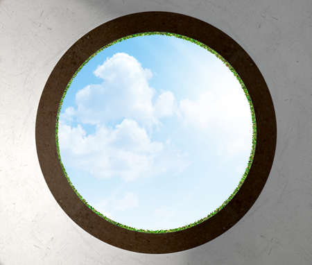 eye hole: A worms eye view out of a golf putting green hole in the daytime