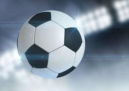 pelota de futbol: Un bal�n de f�tbol regulares volando por el aire sobre un fondo de estadio cubierto durante la noche