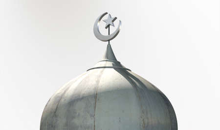 dome: A closeup of the top of a mosque minaret with a cupola dome and an islamic crescent moon and star on a blue sky background
