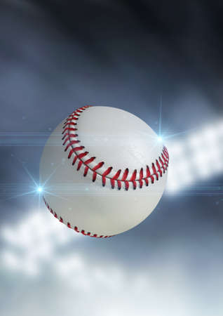 floodlit: A regular baseball ball flying through the air on an indoor stadium background during the night