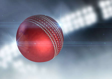 cricket game: A regular red cricket ball flying through the air on an indoor stadium background during the night
