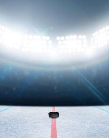 얼어 붙은 표면과 일반 아이스 하키 아이스 링크 경기장 및 조명 투광 조명 아래 하키 퍽 스톡 콘텐츠 - 43636090