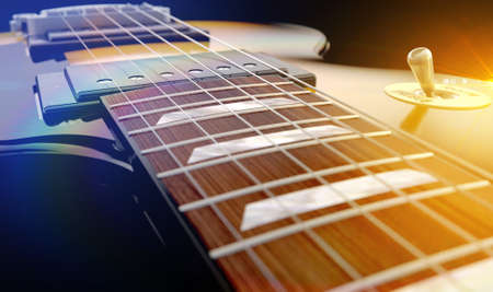 frets: An abstract closeup of the body section of an electric guitar under dramtic lighting conditons