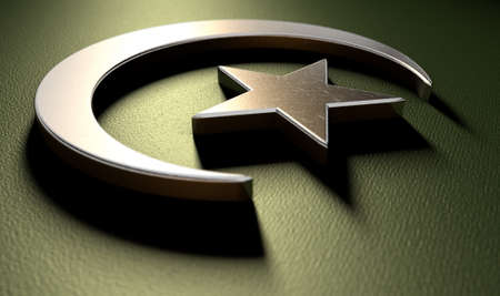 crescent: A metal islamic crescent moon and star on a green textured background