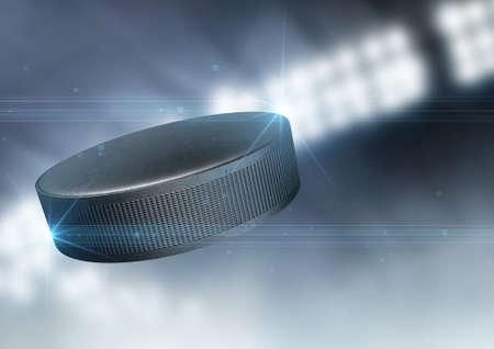 Een regelmatige ijshockey puck vliegen door de lucht op een indoor stadion achtergrond tijdens de nacht