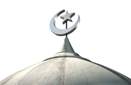 minaret: A closeup of the top of a mosque minaret with a cupola dome and an islamic crescent moon and star on a blue sky background