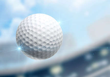 golf ball: A regular golf ball flying through the air on a stadium background during the daytime