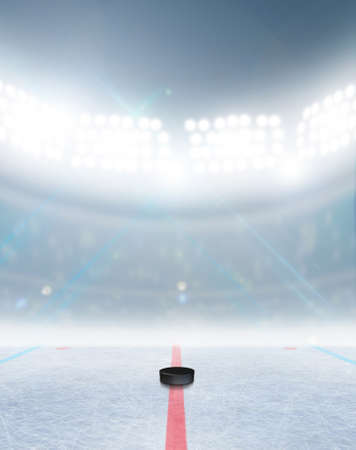 ice surface: A generic ice hockey ice rink stadium with a frozen surface and a hockey puck under illuminated floodlights