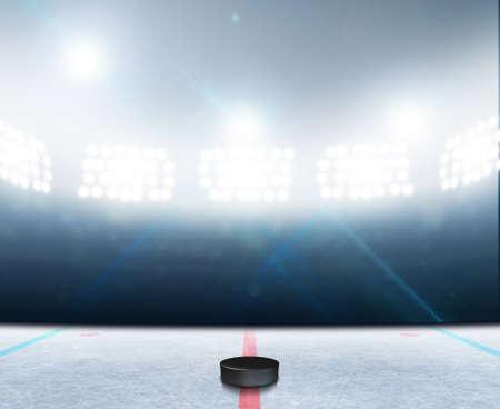 얼어 붙은 표면과 일반 아이스 하키 아이스 링크 경기장 및 조명 투광 조명 아래 하키 퍽 스톡 콘텐츠 - 43635565