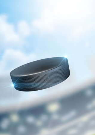 ice hockey puck: A regular ice hockey puck flying through the air on a stadium background during the daytime