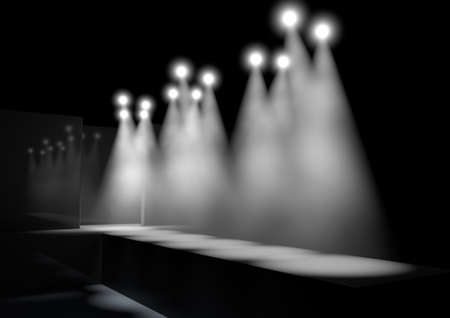 runway fashion: A fashion runway stage lit by a row of spotlights on a dark background Stock Photo