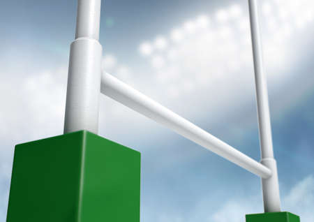 floodlit: A closeup of rugby posts in a stadium under floodlights at night