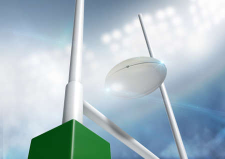 floodlights: A closeup of rugby ball flying between rugby posts in a stadium under floodlights at night