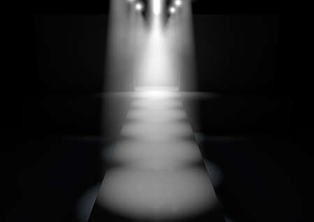 staging: A fashion runway stage lit by a row of spotlights on a dark background Stock Photo