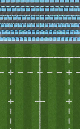 ringside: A direct top view of a section of a rugby stadium with a marked grass field in the daytime Stock Photo