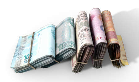 bankroll: Five wads of folded stacks of banknotes representing the BRICS countries each bound infomally by a rubber band set out in a domino formation on an isolated white studio background