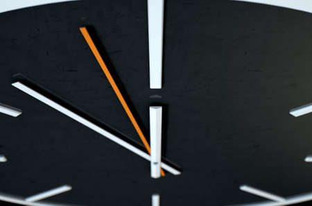An extreme close up of a modern simplistic watch face on an isolated studio background