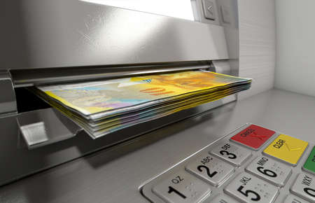 withdrawn: A closeup view of a generic atm facade with an illuminated sceen and keypad and a wad of Swiss Franc banknotes being withdrawn from it Stock Photo