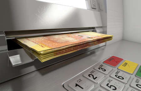 A closeup view of a generic atm facade with an illuminated sceen and keypad and a wad of South African rand banknotes being withdrawn from it Stock Photo
