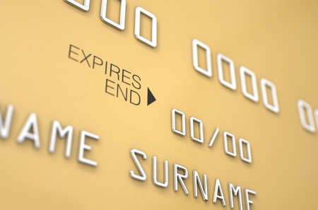 generic: A closeup view of a gold generic blank bank credit card on an isolated white studio background