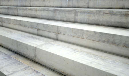 viewers: A section of empty concrete steps used for stadium seating