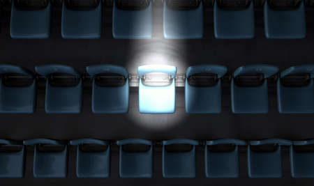 turnout: A section of numbered stadium seating set in rows oin the dark with one seat  being singled out by a spotlight