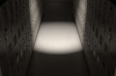 dramatically: A direct top view of a row of regular school lockers in a corridor dramatically lit by a single spotlight