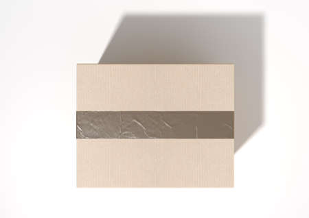 taped: A regular brown cardboard box taped shut on an isolated white studio background Stock Photo