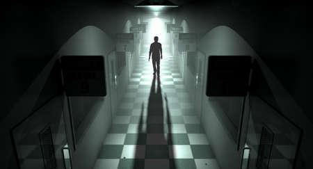 hospitales: Una figura fantasmal proyecta una larga sombra en el medio de un pasaje con poca luz de un asilo mental en ruinas Foto de archivo