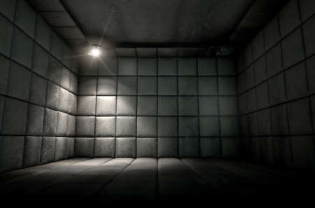 nuthouse: A dark dirty white padded cell in a mental hospital with a corner lit by a single spotlight