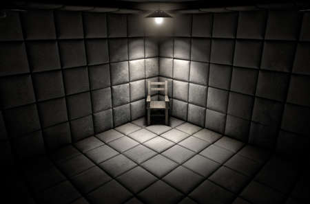 cell: A dark dirty white padded cell in a mental hospital with an empty chair in the corner lit by a single spotlight