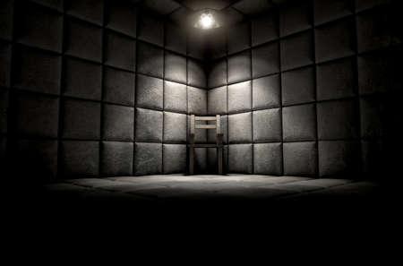 Eine dunkle schmutzige weiße Gummizelle in einer psychiatrischen Klinik mit einem leeren Stuhl in der Ecke von einem einzigen Scheinwerfer beleuchtet Standard-Bild - 51285081