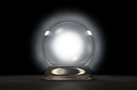 psychic: A regular glowing crystal ball on an isolated dark studio background Stock Photo