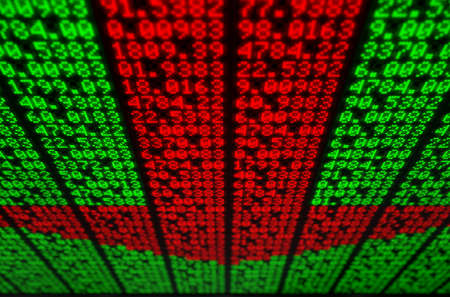 A flat section of a digital stock market indicator board with red numbers making up a downward facing arrow Stock Photo