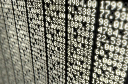 A flat section of a digital stock market indicator board with numerical figures Stock Photo