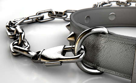 masochism: A black leather dog collar with metal spiked studs attached to a metal chain isolated on an isolated white studio background Stock Photo