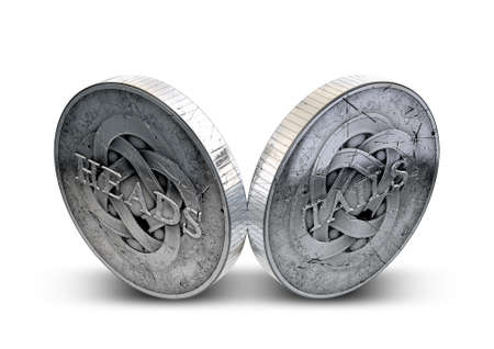 double the chances: A concept image showing both sides of an antique coin displaying a heads and a tails side on an isolated white studio background
