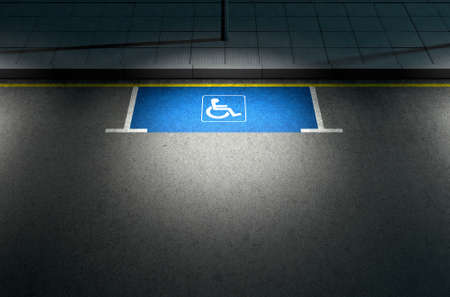 parking space: A section of a tarmac road with an empty demarcated paraplegic parking area at night lit by a street pole light