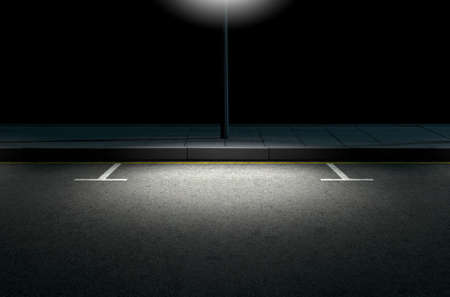 A section of a tarmac road with demarcated parking areas next to a pavement lit by a street pole at night Zdjęcie Seryjne - 52526514