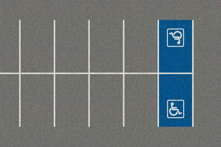 A section of an empty parking lot with an empty demarcated paraplegic parking area Stock Photo