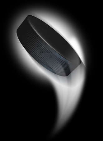 A ice hockey puck swooshing into the atmosphere from a distance on an isolated black background Stock Photo