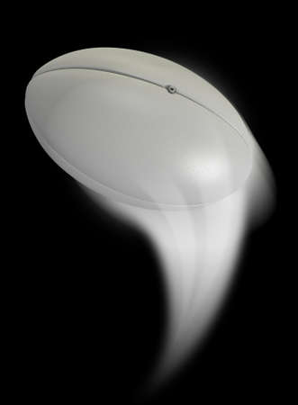 swish: A rugby ball swooshing into the atmosphere from a distance on an isolated black background Stock Photo