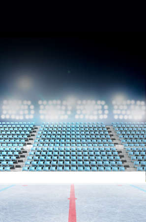 floodlit: An ice hockey stadium with a marked ice rink at night under illuminated floodlights
