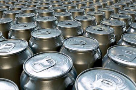 A collection of tin drink cans at the end of a factory production line
